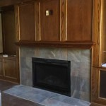 The finished fireplace and wood paneling in the new welcome area.
